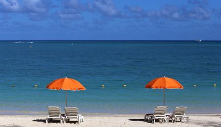 parasols: Parasols and beach in Mauritius island Stock Photo