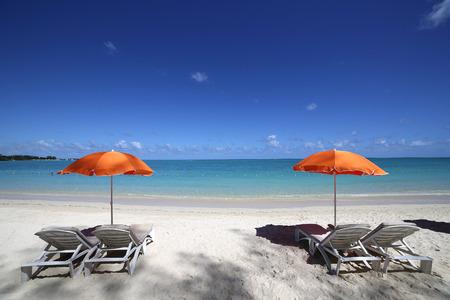 parasols: Parasols on Mont-Choisy beach,  in Mauritius island, indian ocean