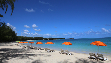indian ocean: Parasols on Mont-Choisy beach,  in Mauritius island, indian ocean
