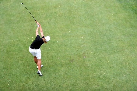 putt: Lady golf in action at swing on a golf course