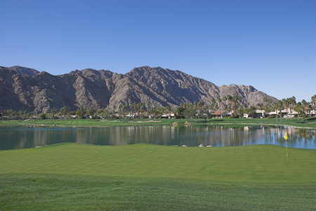 golf course with fairway and green