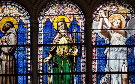 PARIS, FRANCE, APRIL 19, 2017 : interiors, stained glasses and details of notre dame de la compassion church, april 19, 2017, in  Paris, France Editorial