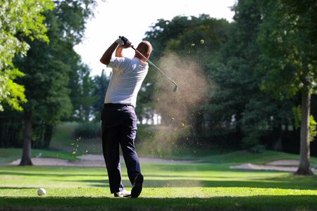 man golfer in action on a golf course Stockfoto