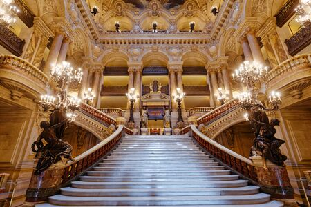 PARIS, FRANCE, MARCH 14, 2017 : big staircase and architectural details of the palais Garnier, Opera of Paris, march 14, 2017 in Paris, France. Редакционное