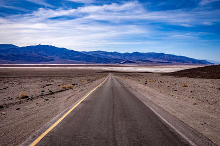 road lines in death valley desert, california, usa