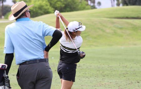 RANCHO MIRAGE, CALIFORNIA - MARCH 31, 2015 : David Leadbetter and Lydia Ko of new zealand at the ANA inspiration golf tournament on LPGA Tour, March 31, 2015 at The Mission Hills country club, Rancho Mirage, California Éditoriale