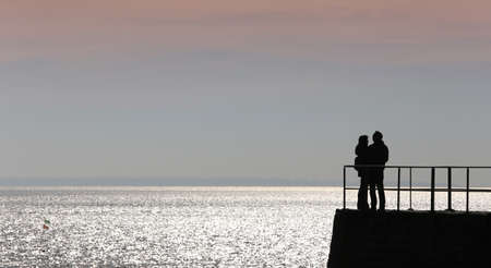 jetty on the ocean at sunset french brittany coastline