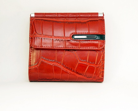 red leather purse separate standing on a white background                              photo
