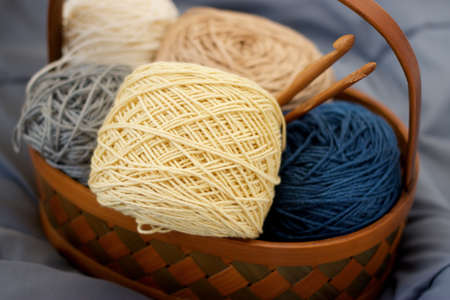 brawn: Ball of yarn beige tone in basket on fabric Stock Photo