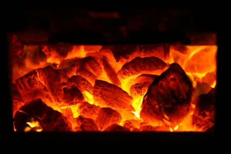 Coal burning in a steam train boiler furnace  Stock Photo