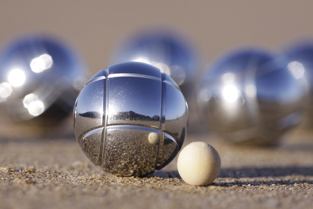 boules: A boules set with Cochonnet on sand