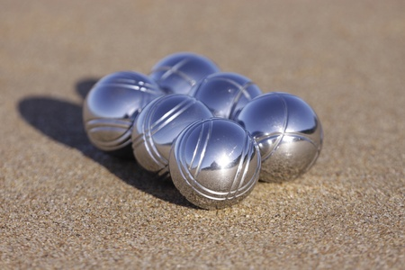 boules: Six boules balls on the beach.  Stock Photo