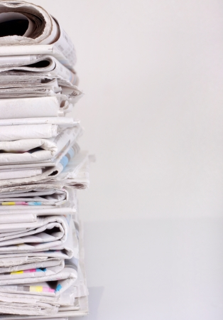 A stack of newspapers isolated on white background with copy space.