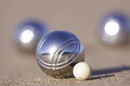 bocce: A boule with a wooden Cochonnet or jack.  Stock Photo