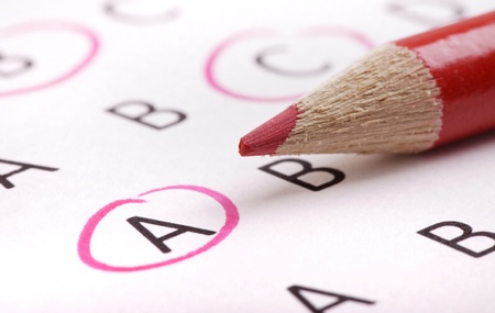 A multiple choice questionaire with red pencil