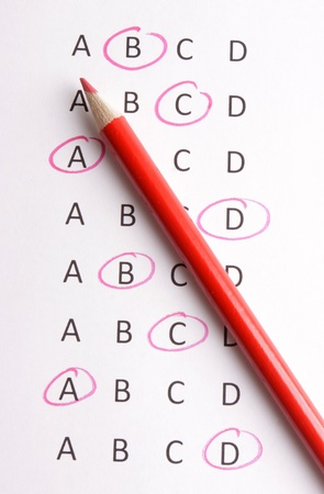 questionaire: A questionaire with a red pencil Stock Photo