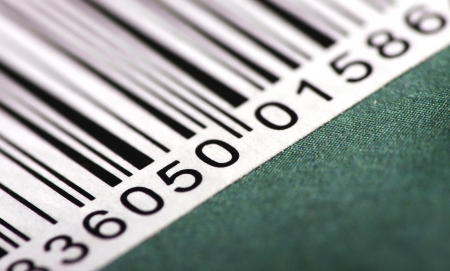 Close up view of a portion of a barcode on a green background
