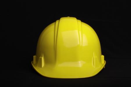 hard hat: Yellow construction helmet isolated on black background Stock Photo