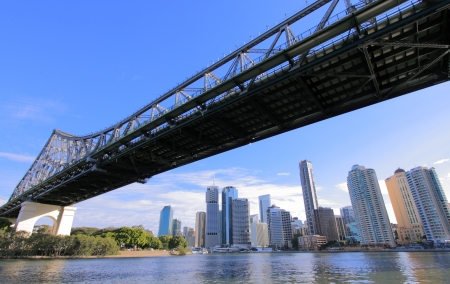 Brisbane CBD viewed from the Brisbane River framed by the Storey Bridge. Stock Photo