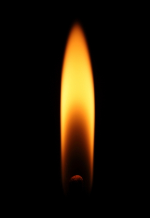 Flame from a lit match isolated on black background Stock Photo - 16437868