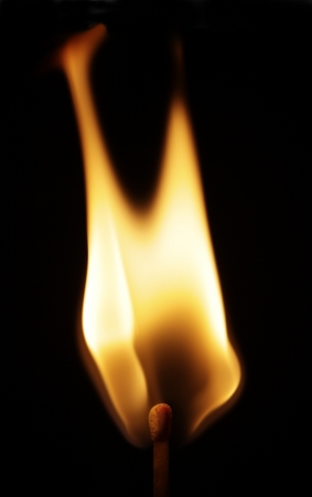 Flame from a lit match isolated on black background. Stock Photo - 16437866
