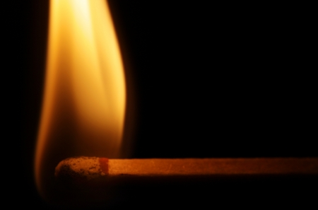 Horizontal lit match with flame isolated on black background. Stock Photo - 16437864