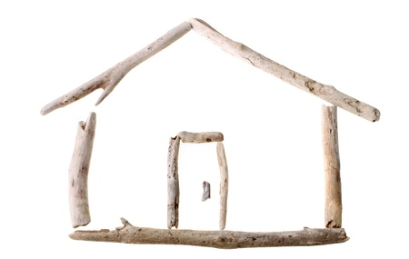 Sun bleached drift wood in shape of a house isolated on white background Stock Photo