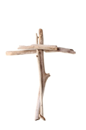 humility: Christian Cross made from sun bleached drift wood symbolising purity and humility isolated on white background Stock Photo