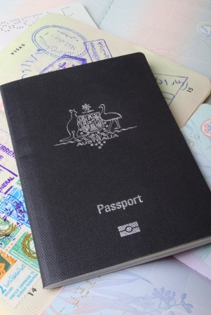 Australian passport sitting on open passport pages showing visas.