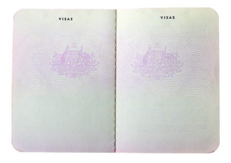 Blank old Australian passport pages isolated on white background. Stock Photo