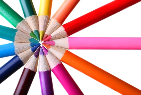 Color pencils in a circle forming spokes of a color wheel  Stock Photo