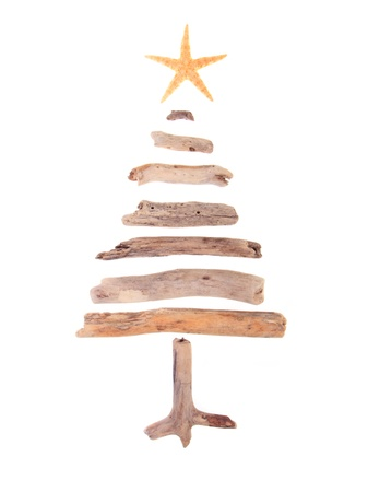 driftwood: Christmas tree made from drift wood and a starfish star isolated on white background