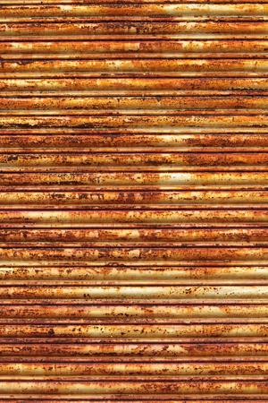 vertical orientation: Rusted garage door background vertical orientation. Stock Photo
