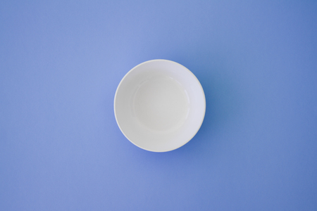 Top view photo of white plate. Very minimal and clean style.