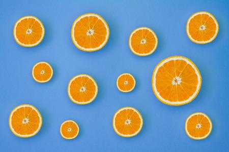 Minimal photo of fresh orange on bright background.