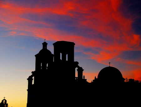 finest: Sunset at the San Xavier Mission. The church is considered by many to be the finest example of mission architecture in the United States. It is a graceful blend of Moorish, Byzantine and late Mexican Renaissance architecture. Stock Photo