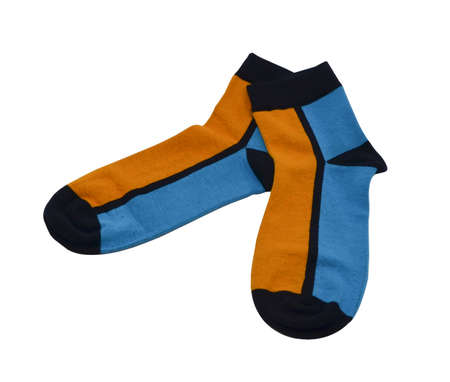 on a white background a pair of multicolored socks laid out and isolated