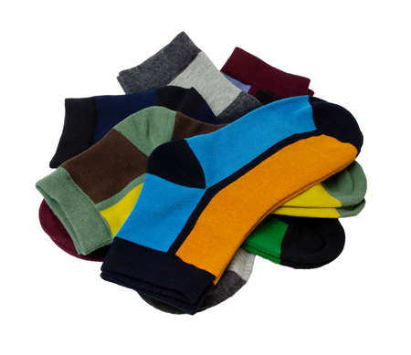 on a white background a lot of multicolored socks are laid out and isolated