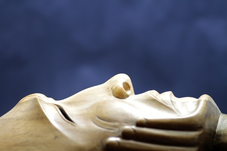wooden sculpture expresses the pain and disappointment to the global economic crisis photo