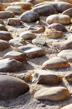 hardness: scene of boulders on the floor expressing hardness and texture highlighting