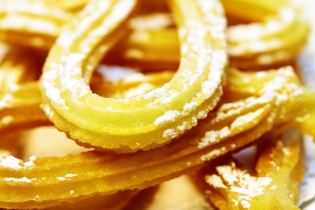 accompaniment: Typical breakfast of churros with accompaniment Stock Photo