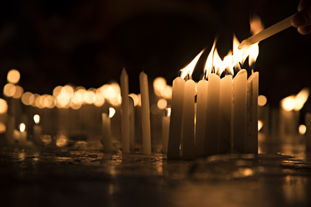 buddhism prayer belief: Lightening the candles
