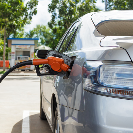 fill up fuel at gas station photo