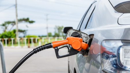 Refill and filling Oil Gas Fuel at station photo