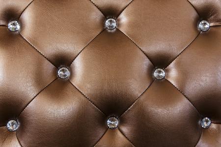 vintage brown leather sofa texture with diamon decoration photo