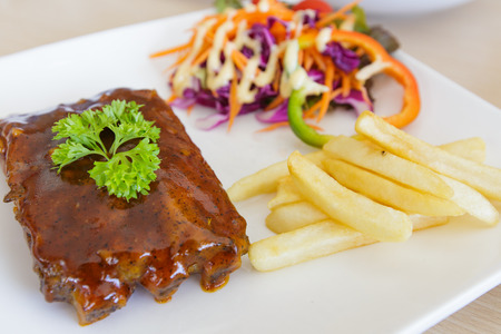 BBQ ribs with french fries photo