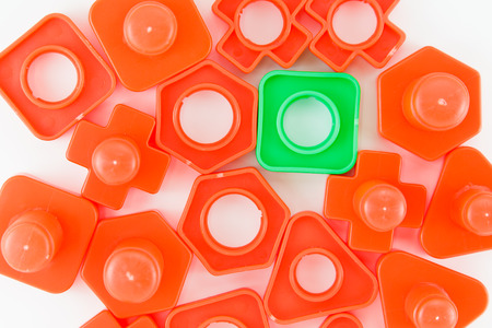 tot: colorful plastic toy, bolts and nuts on a white background