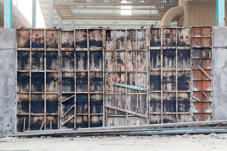 permanence: Factory wall under construction with concrete Stock Photo