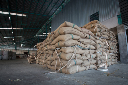 Hemp sacks containing rice in warehouse Editorial