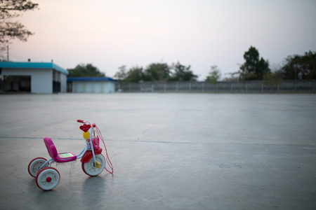 plastic toys: bike plastic toys for kids at sun set Stock Photo